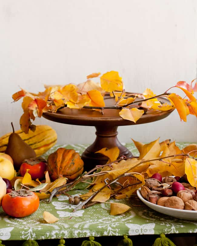 thanksgiving centerpiece - start arranging leaves on stand-2