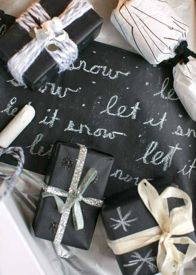 chalkboard style wrapping paper using black craft paper and chalk to write christmas messages on