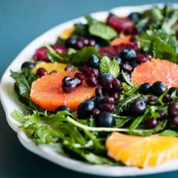 Baby Kale Salad with Oranges, Blueberries and Pomegranate | HelloGlow.co