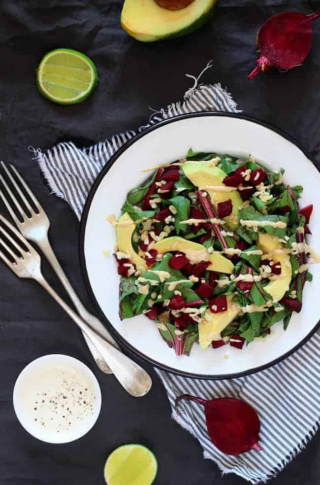Beet Greens with Avocado and Creamy Tahini Dressing Recipe | HelloGlow.co