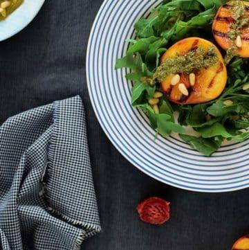 Arugula Salad with Grilled Peaches and Vegan Basil Pesto   HelloGlow.co