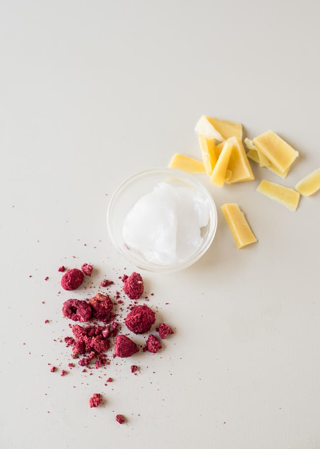 All-Natural DIY Tinted Lip Balm with Raspberries | HelloGlow.coonut oil beeswax freeze dried raspberries