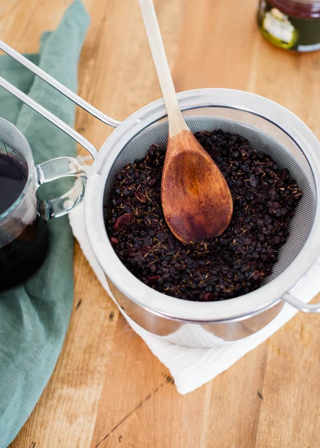 Strained Homemade Elderberry Syrup | HelloGlow.co