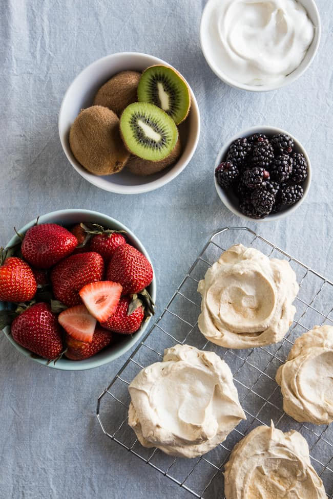Pavlovas with sweetened whipped cream and a variety of fresh fruit ...