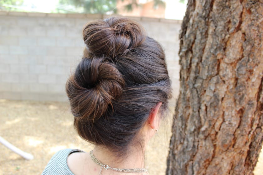 Double bun by Reece Gabrielle | 10 Stylish Workout Hairstyles