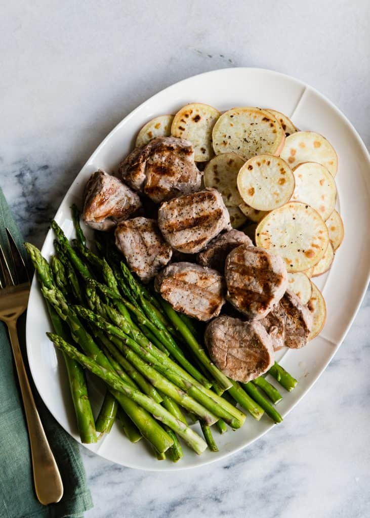 Pork Tenderloin Medallions with Asparagus and Sweet Potato Rounds | HelloGlow.co