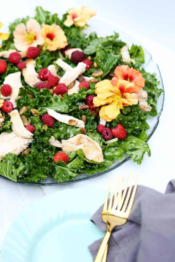 Raspberry Kale Salad with Edible Flowers from One Armed Mama
