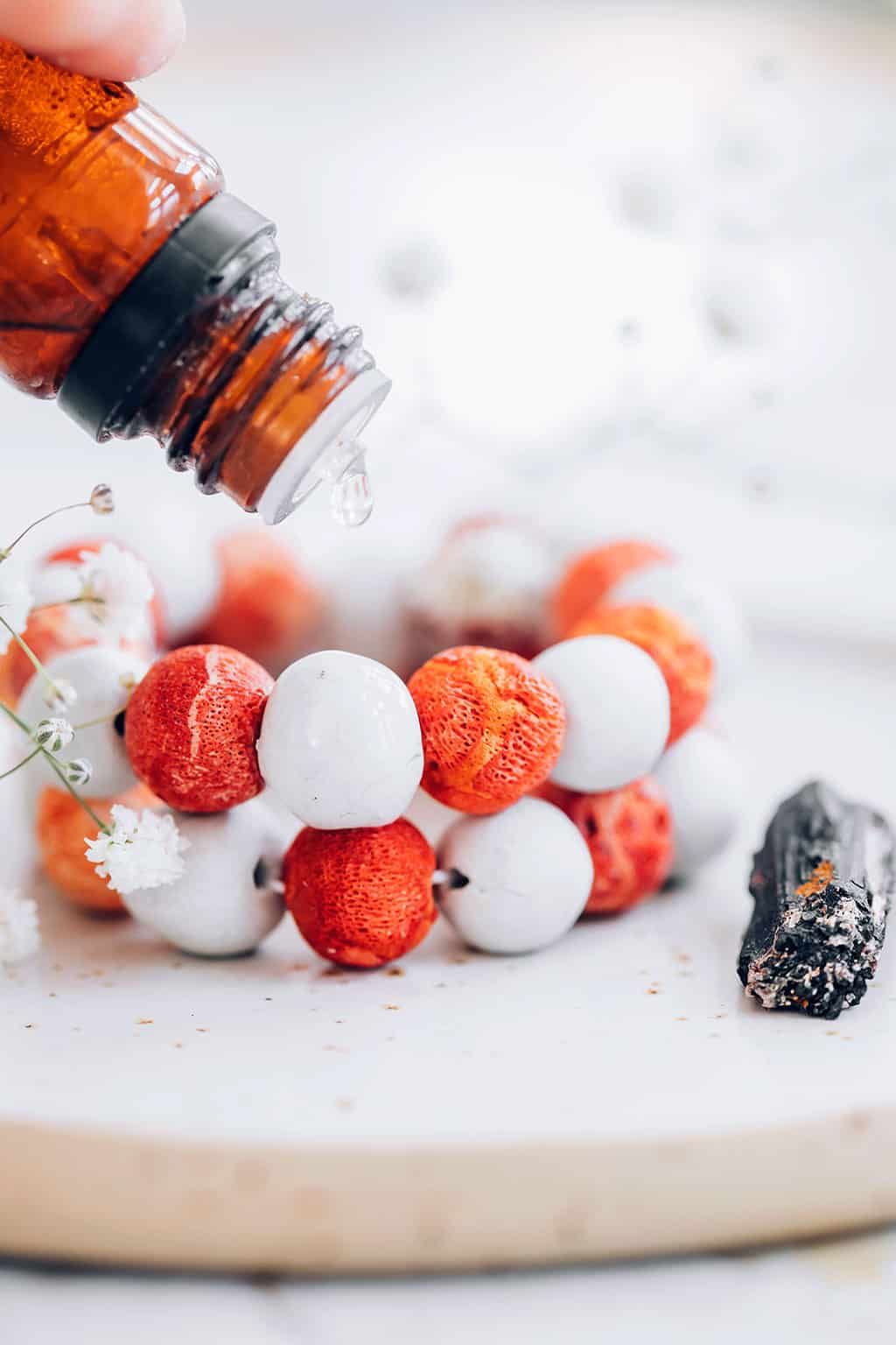 Add essential oils to you bead diffuser bracelet