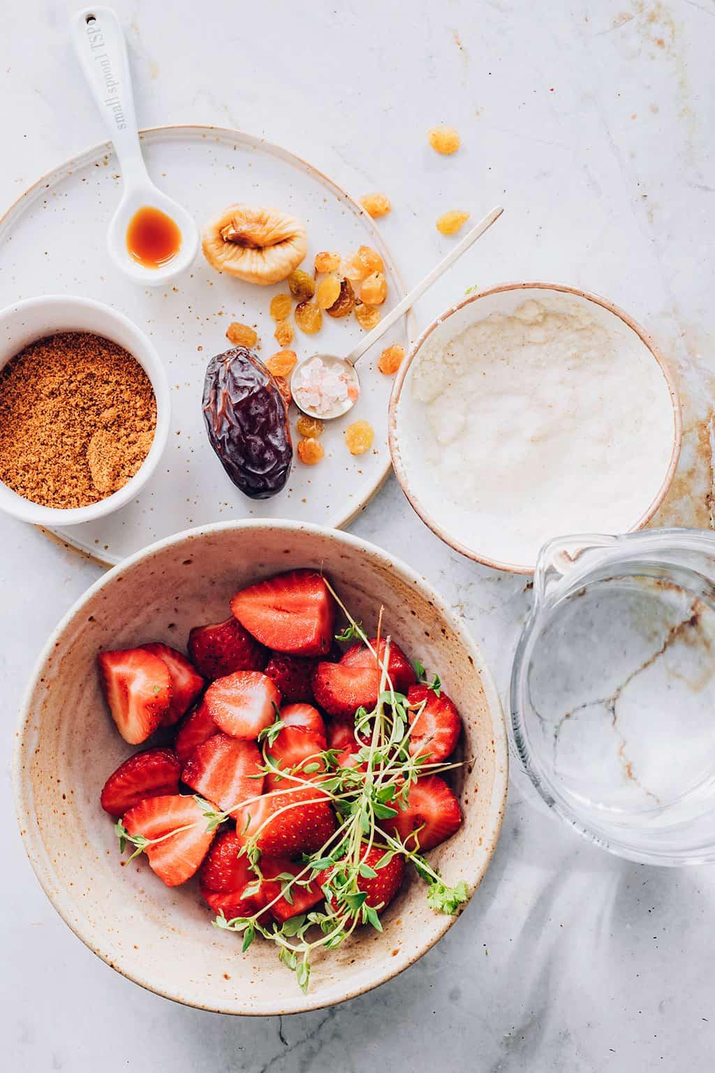 Ingredients for making strawberry thyme water kefir beverage recipe