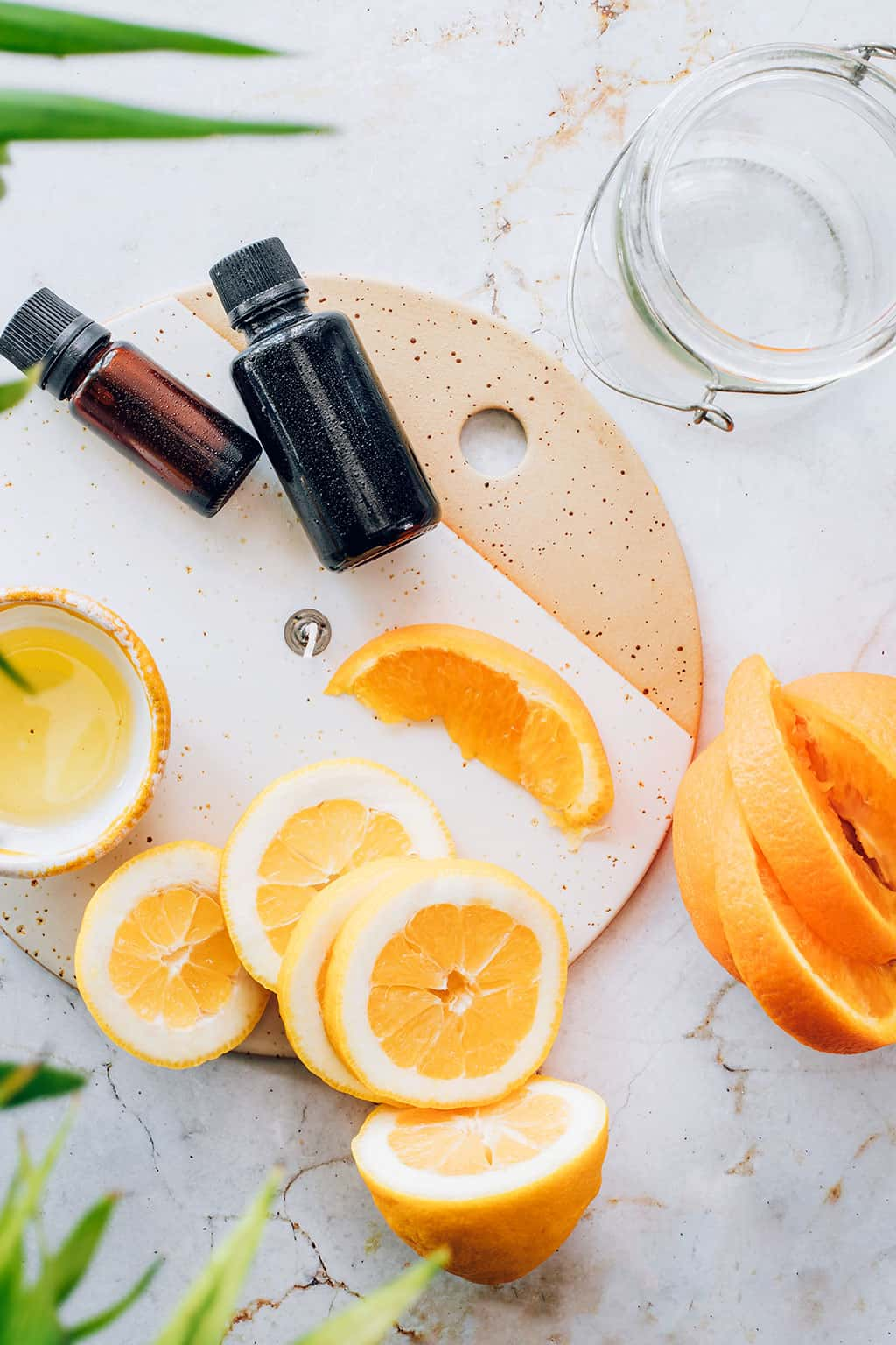Ingredients for making easy candles with oil, fruit and mason jars