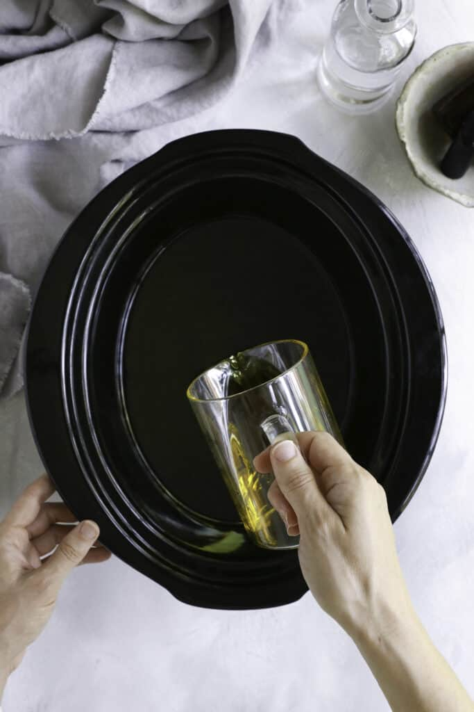 Adding olive oil to crockpot for making olive oil soap