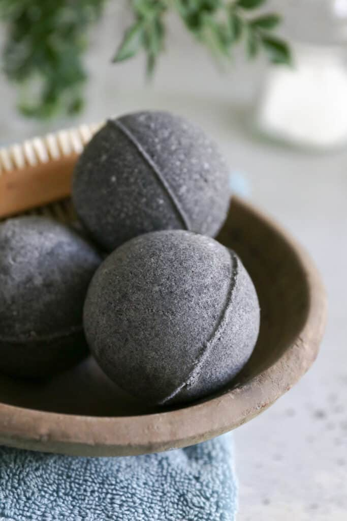 With soothing essential oil and activated charcoal, these black bath bombs are just what you need to calm irritated skin and get a relaxing soak too.